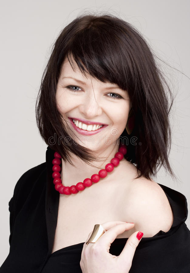 Young Beautiful Woman with Dark Brown Hair Smiling royalty free stock images
