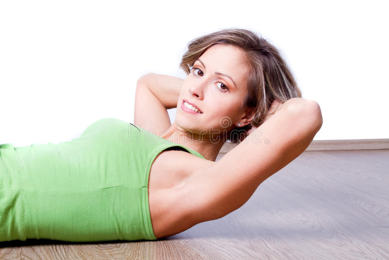 Young Beautiful Woman Doing Fitness Exercise Stock Photos