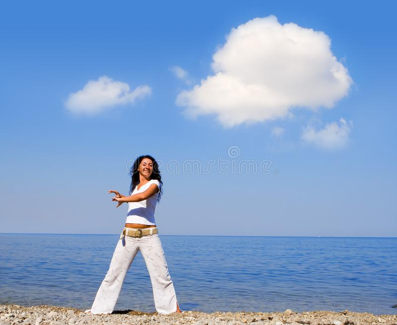 Young beautiful woman doing fitness exercises royalty free stock photography