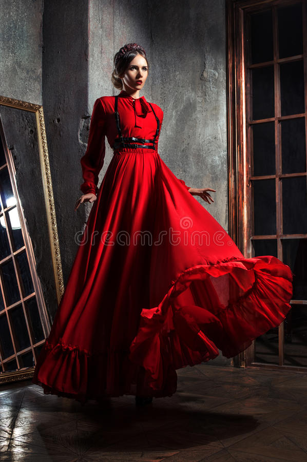 Young beautiful woman in dress royalty free stock images
