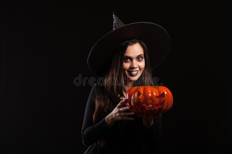 Young beautiful woman dressed up like a witch for halloween royalty free stock photos