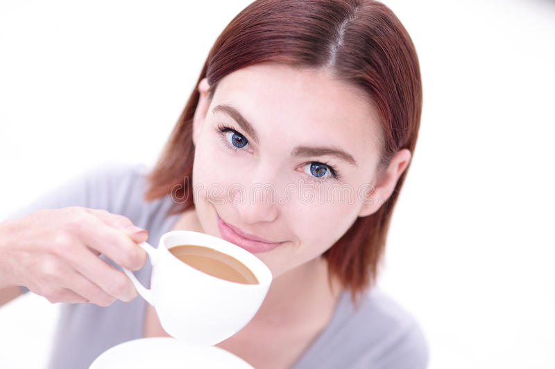 Young beautiful woman drink coffee royalty free stock image