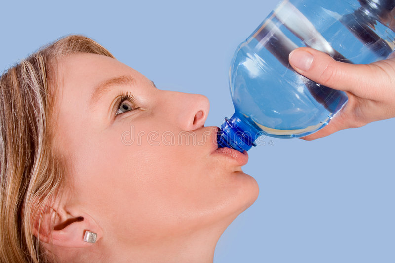 Young beautiful woman drinking stock image