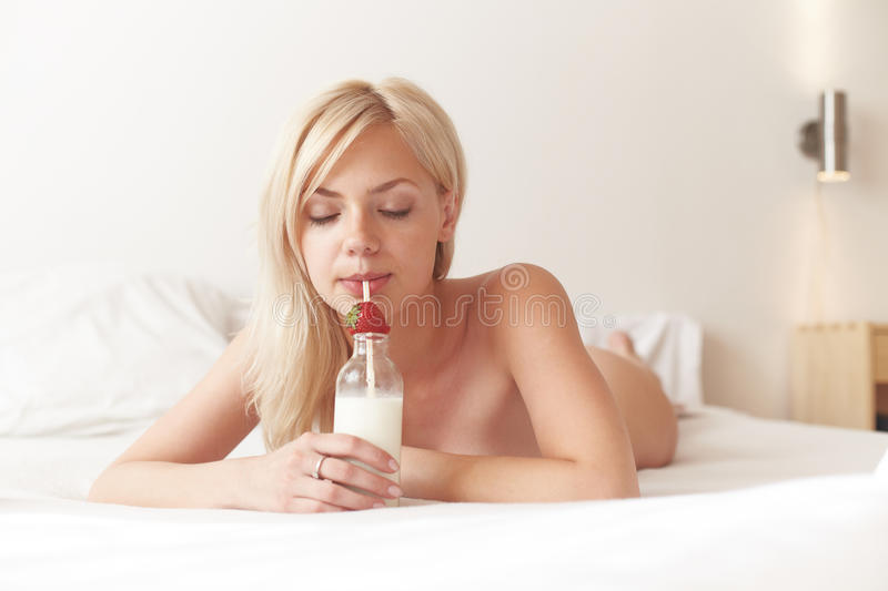 Young Beautiful Woman Drinking Milk Royalty Free Stock Images
