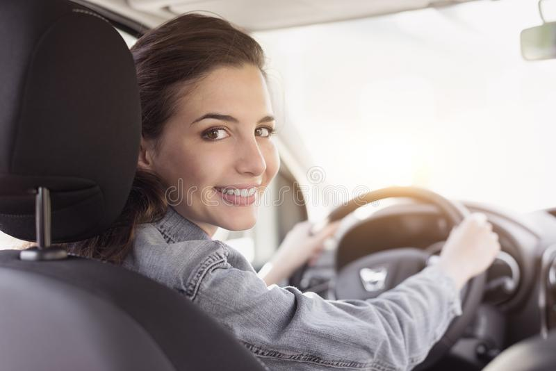 Young woman driving her car stock images