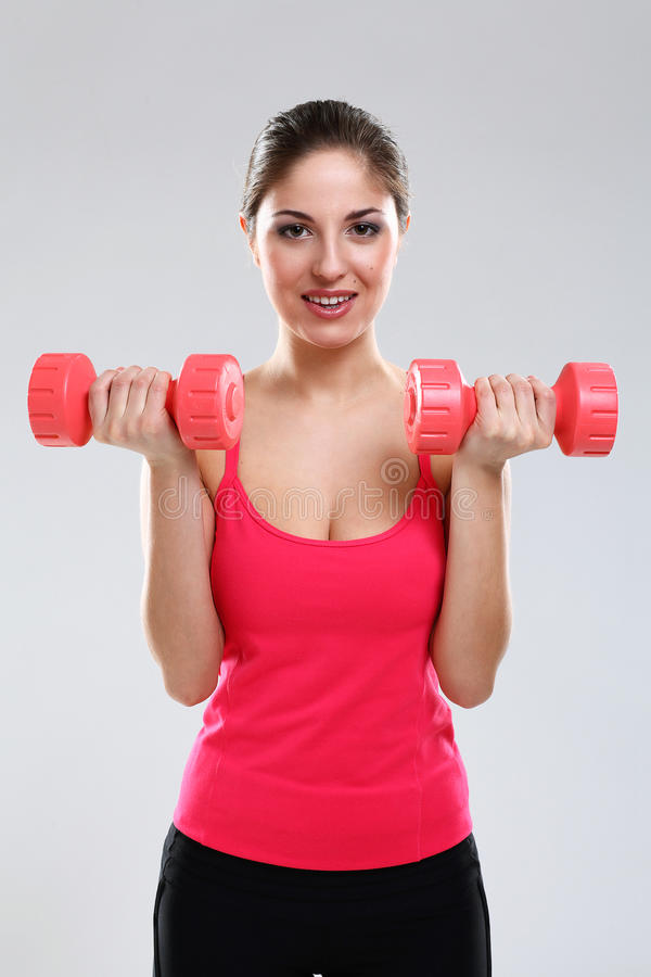 Download Young Beautiful Woman With Dumbbells Stock Photo - Image: 29624892