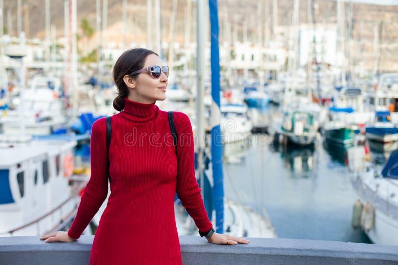 Young beautiful woman enjoying summer vacation in a small fishing port of Puerto de Mogan, Gran Canaria, Spain stock image