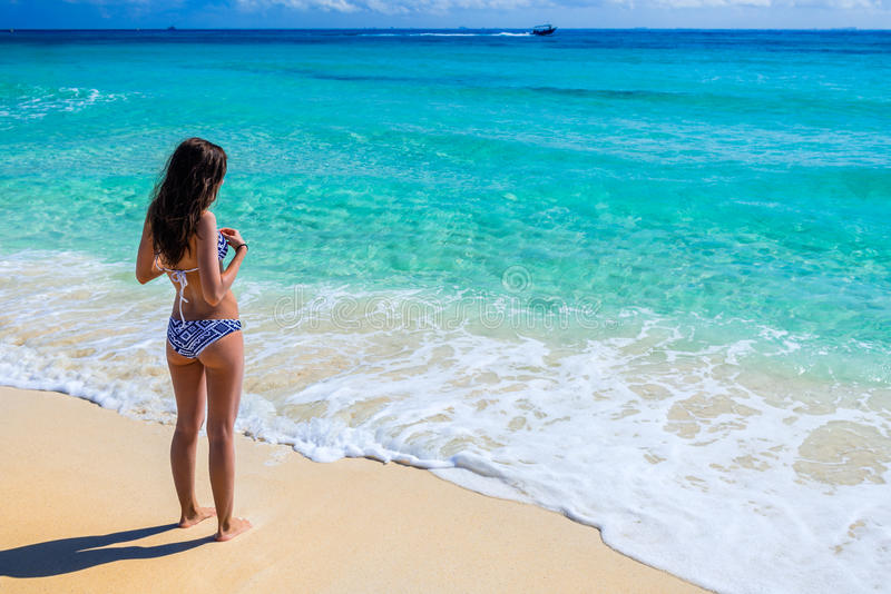 Young beautiful woman enjoying at the tropical ocean. Gorgeous g royalty free stock images