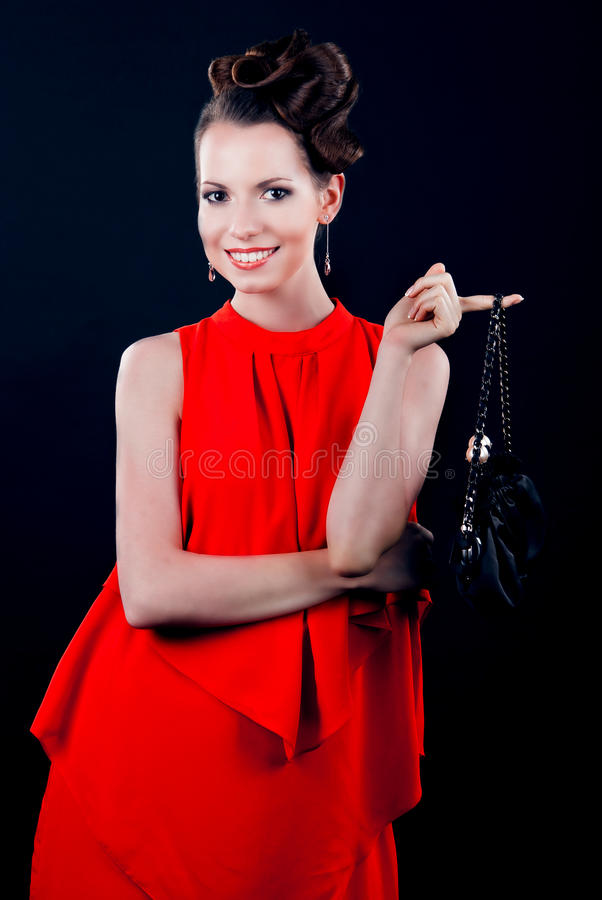Young beautiful woman in evening gown royalty free stock photography