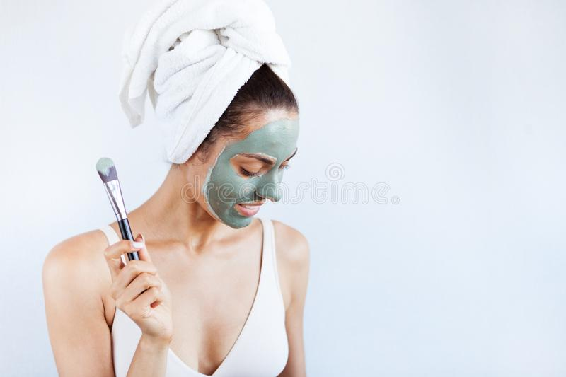 Young beautiful woman in face mask of therapeutic blue mud. Spa royalty free stock photography