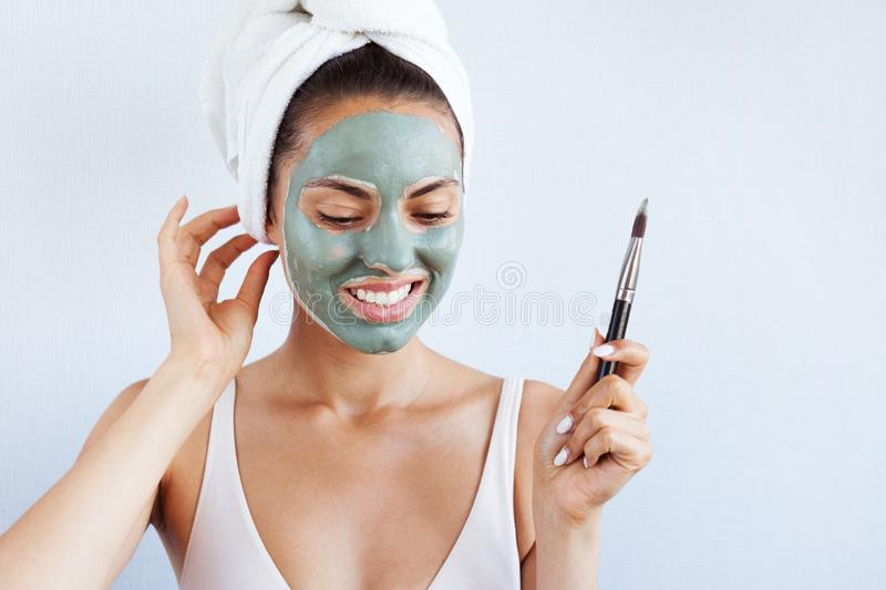 Young beautiful woman in face mask of therapeutic blue mud. Spa stock images