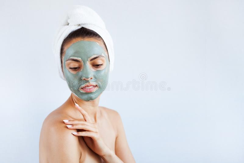 Young beautiful woman in face mask of therapeutic blue mud. Spa royalty free stock photo