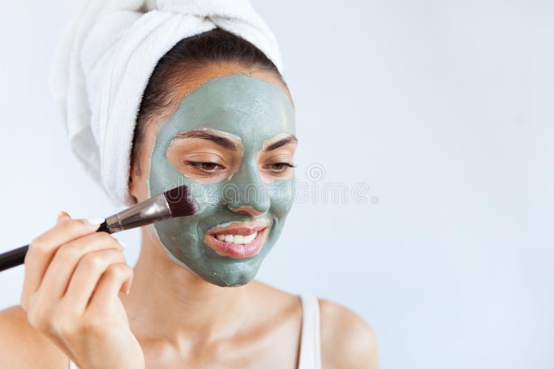 Young beautiful woman in face mask of therapeutic blue mud. Spa stock photography