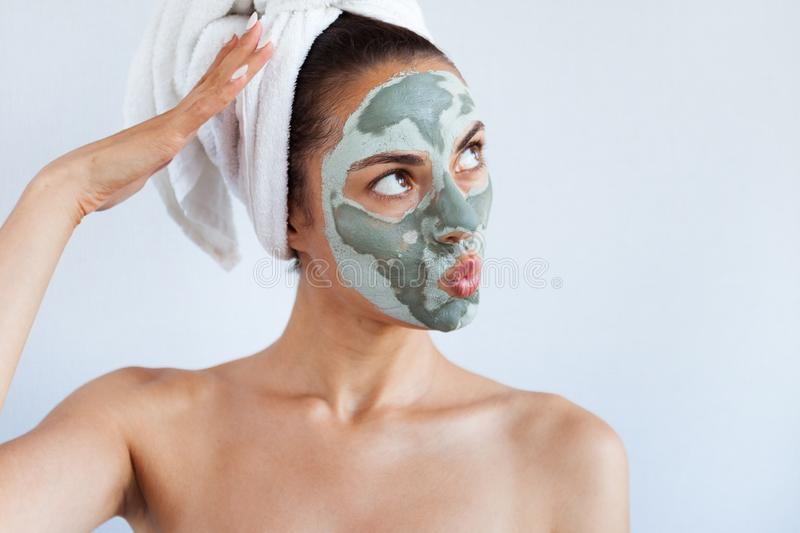 Young beautiful woman in face mask of therapeutic blue mud. Spa stock photos
