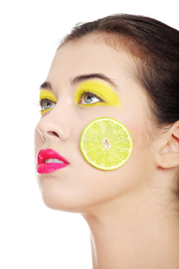 Young beautiful woman face with yellow eye make up royalty free stock photography