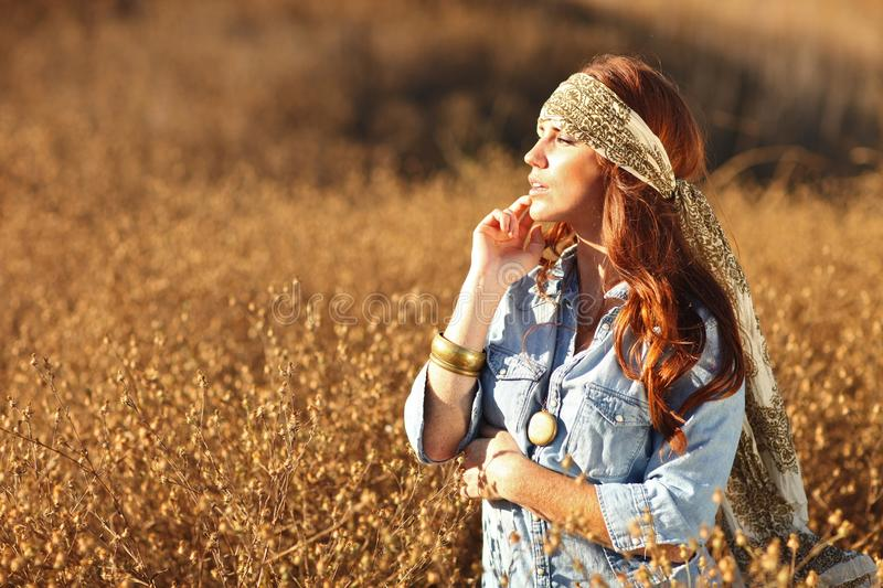 Download Young Beautiful Woman On A Field In Summer Time Stock Photo - Image of friendly, flower: 20104164
