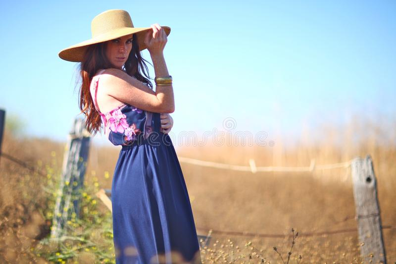 Download Young Beautiful Woman On A Field In Summer Time Stock Photo - Image: 20104178