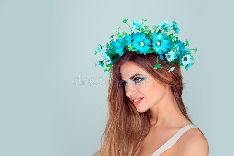 Woman with floral crown on head smiling in side profile stock photography