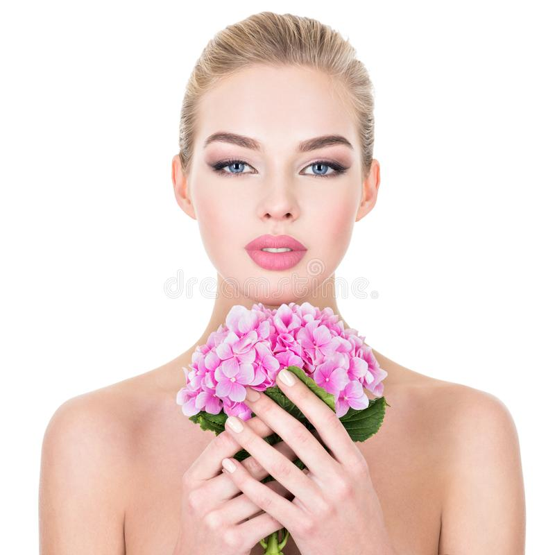 Young beautiful woman with flowers near face. royalty free stock images