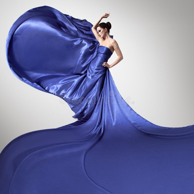 Young beautiful woman in fluttering blue dress. stock photos