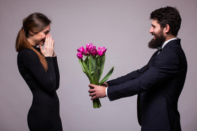 Young beautiful woman get flower bucket from his boyfriend royalty free stock photo
