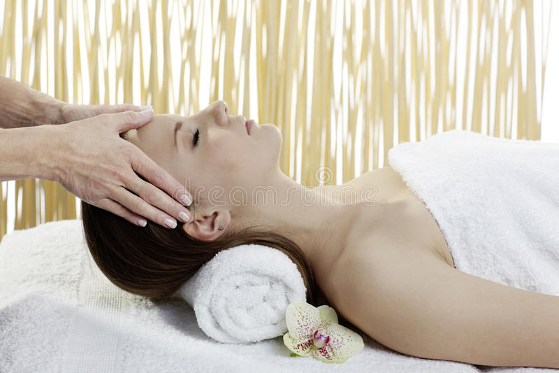 Young beautiful woman getting spa treatment royalty free stock photos