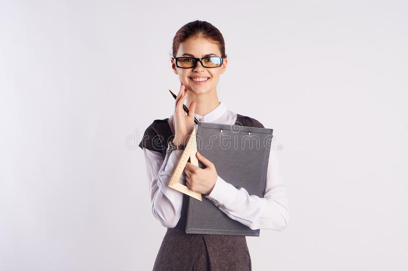 Young beautiful woman in glasses on a white background, teacher, teach, director, study.  royalty free stock photo