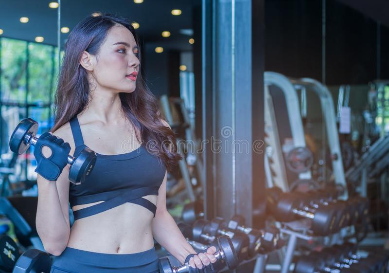 Young  beautiful woman good figure doing exercises  in gym. new generation of women who are health conscious. Healthy exercise royalty free stock photos