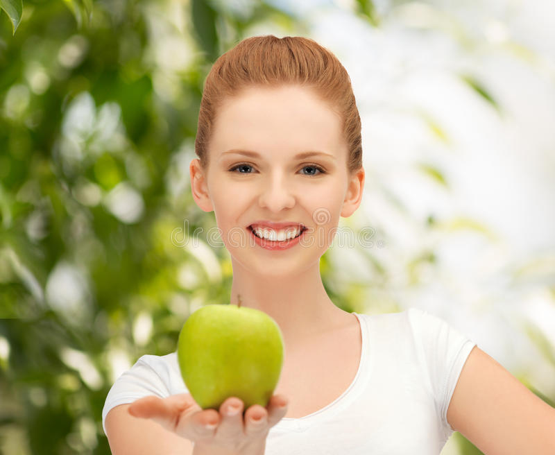 Download Young Beautiful Woman With Green Apple Stock Photo - Image: 38075532