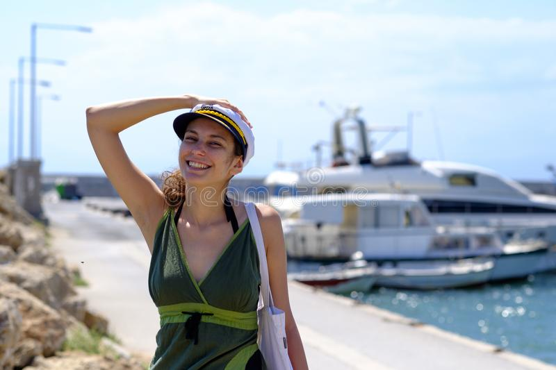 Smiling model posing in front a yacht stock photos