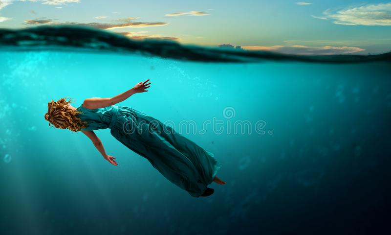 Woman dancer in clear blue water royalty free stock photography