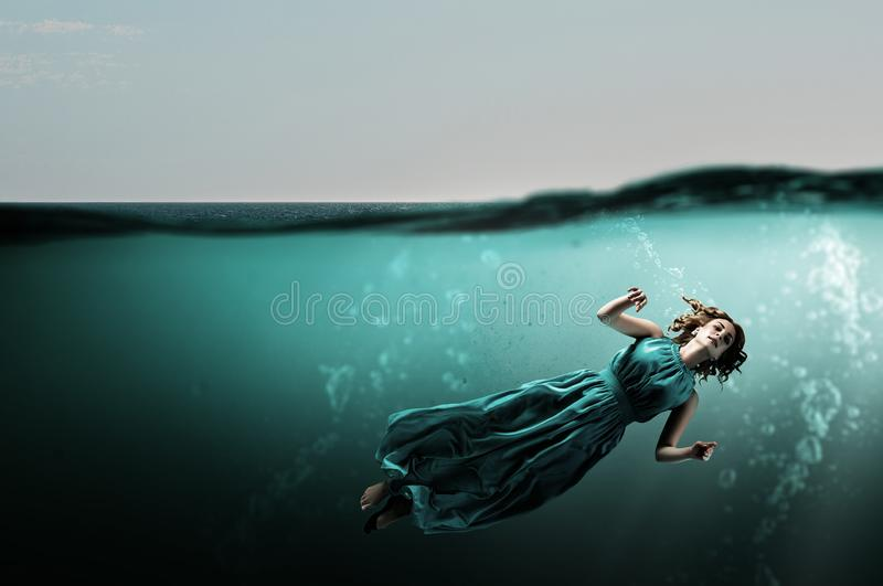 Woman dancer in clear blue water royalty free stock photo