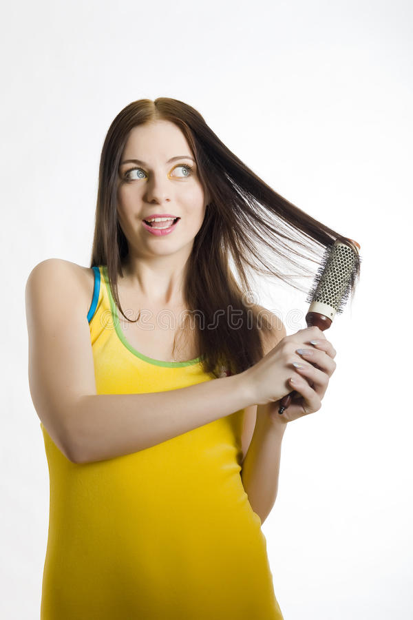 Young beautiful woman with hair brush stock photo