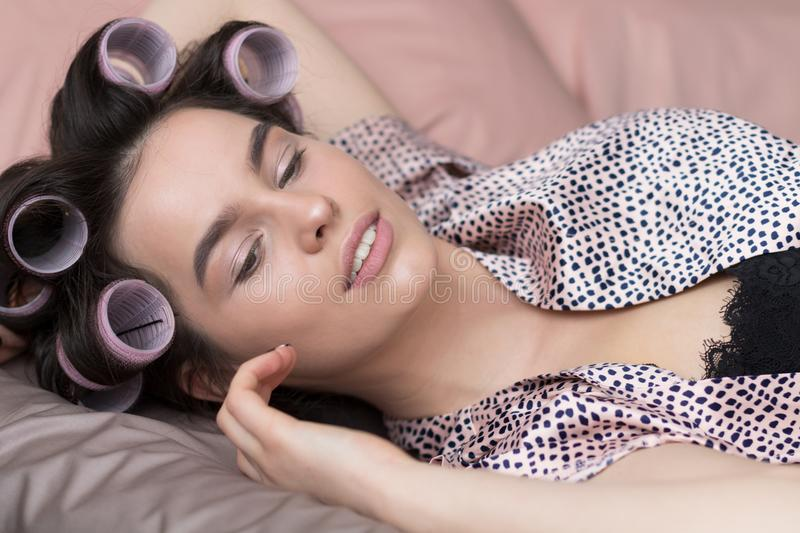Modern Sweet Woman in Hair Curlers. Home Concept royalty free stock photo
