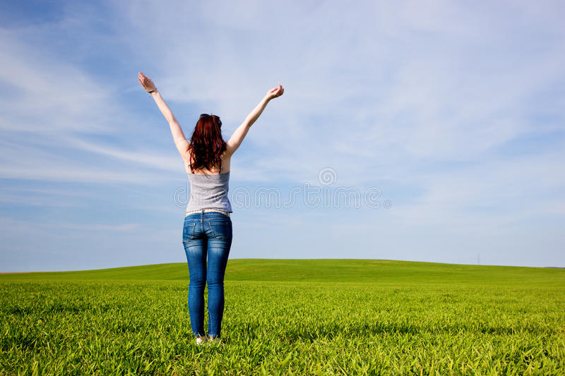 Young beautiful woman with hands up royalty free stock images