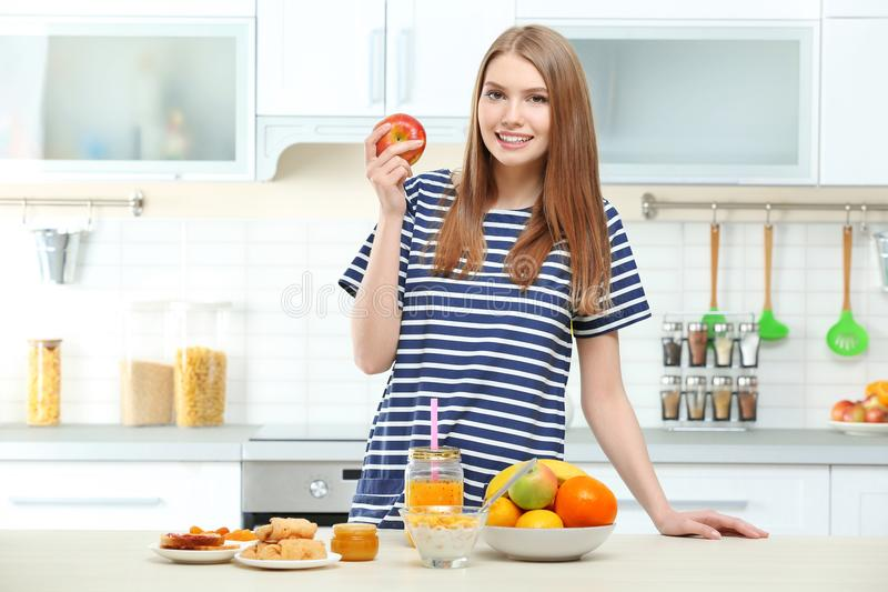 Young beautiful woman having breakfast. In bed stock photography