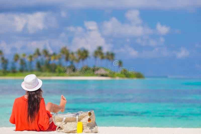 Young beautiful woman having fun on tropical seashore. stock photos
