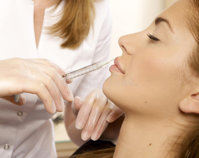Young Beautiful Woman Having An Injection Stock Image
