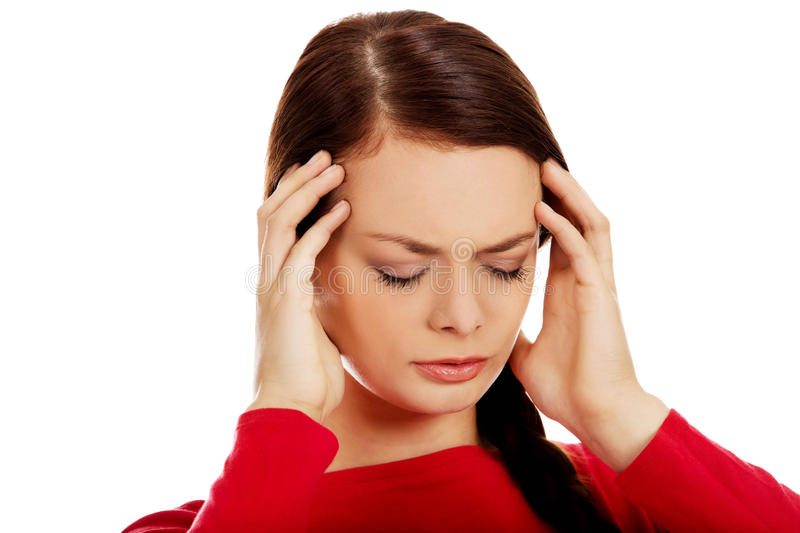 Young beautiful woman with headache royalty free stock photography