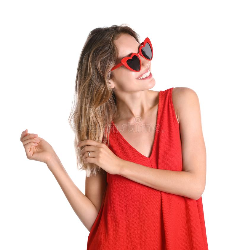 Young beautiful woman  heart shaped glasses on white background royalty free stock images
