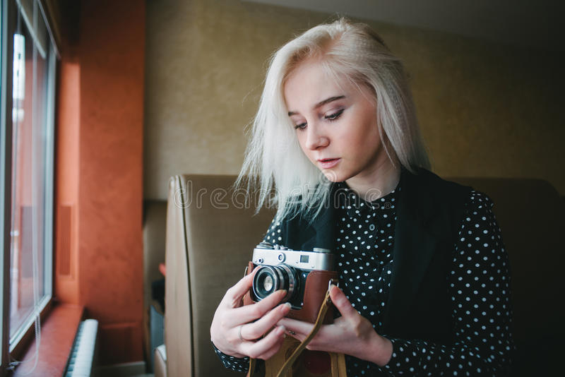 Young beautiful woman hipster holding retro camera stock photos