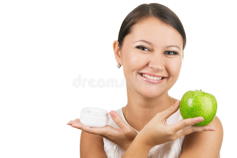 Young beautiful woman holding apple and cream royalty free stock image