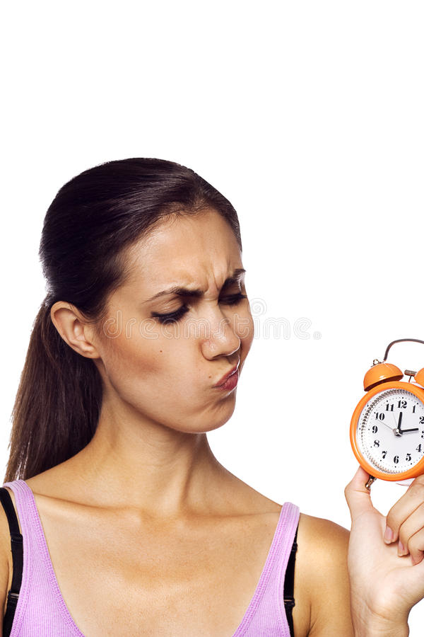 Download Young Beautiful Woman Holding A Clock Stock Photo - Image of punctual, beautiful: 25390828
