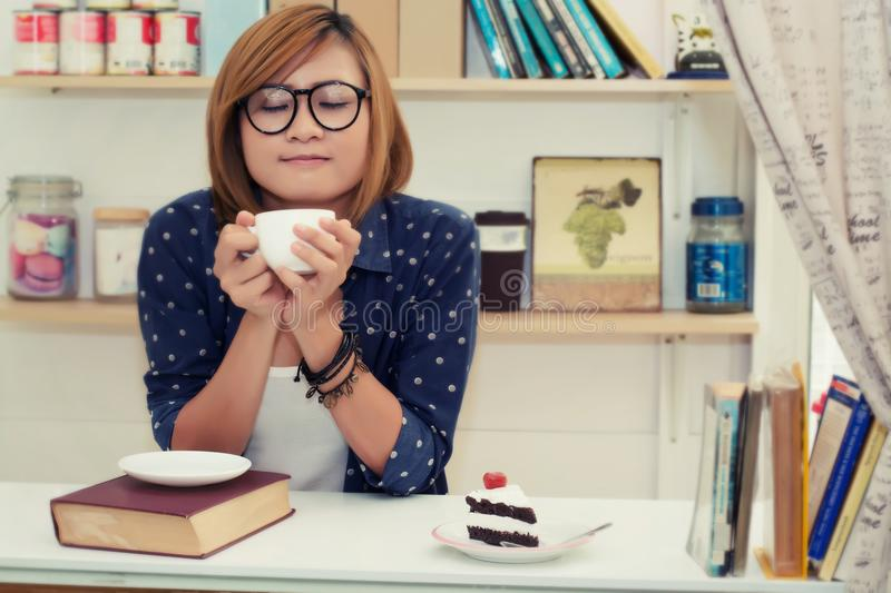 Young beautiful woman holding coffee cup was smell fragrant in c stock photography