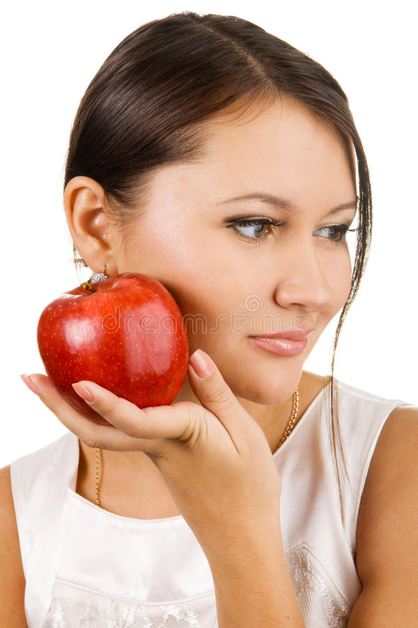 Young beautiful woman holding two apples stock photo