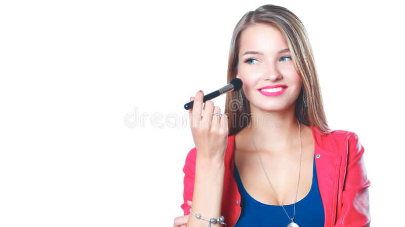 Young beautiful woman holds in hand brush for makeup.  royalty free stock photography