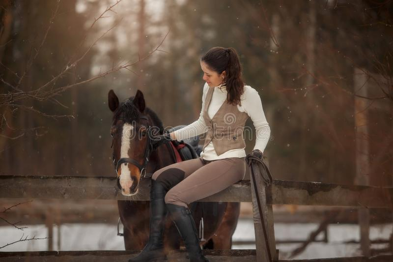 Young beautiful woman with horse outdoor portrait at spring day. Horseback style stock photos