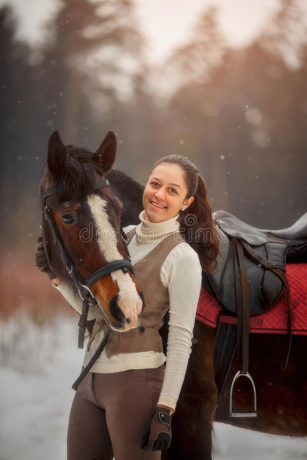 Young beautiful woman with horse outdoor portrait at spring day. Horseback style stock photography