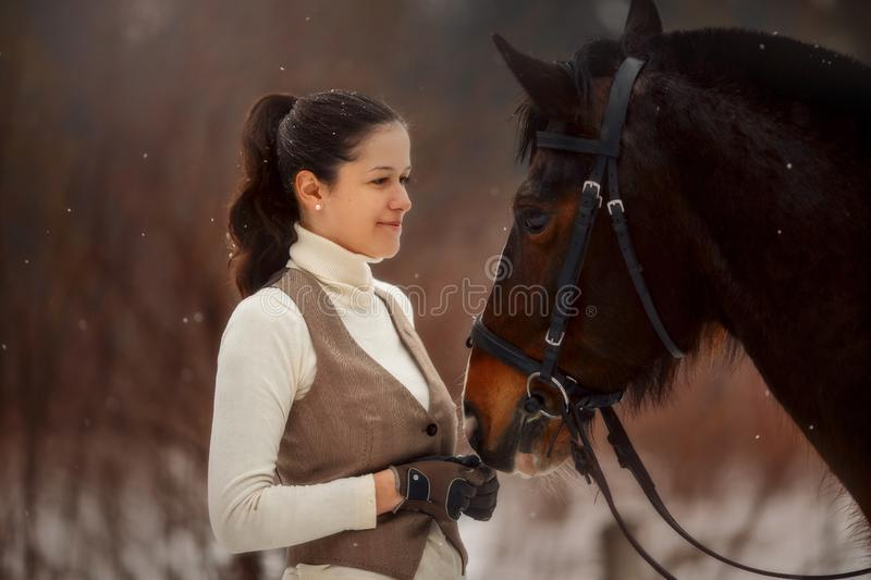 Young beautiful woman with horse outdoor portrait at spring day. Horseback style stock photo