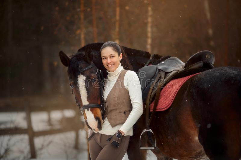 Young beautiful woman with horse outdoor portrait at spring day stock image
